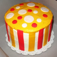 Orange & Yellow Cake This was made for Thanksgiving. It is a yellow cake with BC Icing. I used red & orange fondant stripes & polka dots as accents....