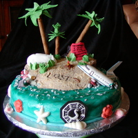 Lost Theme Cake Made for a friend who was having a LOST finale party. Pina Colada cake with Key Lime filling. All edible decorations - fondant, chocolate...