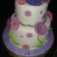 Gerbera Daisy Graduation Cake H.S. Graduation Cake for friend's twin daughters. One wanted purple gerbera daisy theme and other wanted traditional grad cake (...
