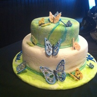 Butterflies  Burthday Cake for friend. Cakes tiers are Mango with Mango Cream filling and Hummingbird Cake with Pina Colada filling. Flavors were a big...