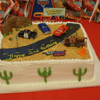 Disney Cars Cake I did this cake for my son's 2nd birthday party. It is 11 x 15, devil's food with chocolate barvarian cream in the middle. It is...