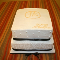 Bridal Shower Cake I did this cake for a friend's bridal shower. It is my second cake and first 2 tier cake. It is a 12 x 12 on the bottom and 10 x 10 on...