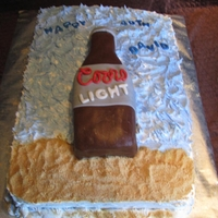 40Th Coors Light Bottle Cake Chocolate cake with whipped cream frosting. Party was at a marina so I added the beach theme to the cake.