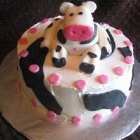 Cow Cake Yellow cake with whipped buttercream frosting, fondant accents