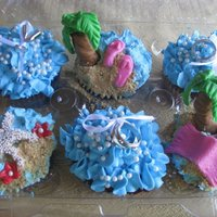 Beach Cupcakes These were for a girls night out before the brides wedding. Red velvet cupcakes with buttercream frosting and fondant accents. Some non...