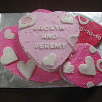 Hearts Bridal Shower Cake Various flavors of cake, funfetti, yellow, and chocolate. Buttercream frosting and fondant accents.