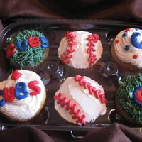 Chicago Cubs Cupcakes Chocolate cupcakes with whipped cream frosting and fondant accents.