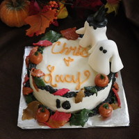 Halloween Anniversary Cake Red velvet cake with cream cheese frosting and fondant accents.