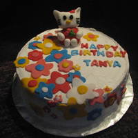 Hello Kitty Cake Chocolate cake with choc ganache filling, whipped cream frosting and fondant accents.