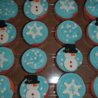 Snowman Cupcakes These were made for a four year olds birthday. He wanted strawberry cupcakes with snowmen on top.