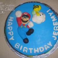 Super Mario Bros. Cake Super Mario cake for a friend's son's birthday. Cake is covered in fondant, all decor is fondant. Mario and Lakitu on top are...