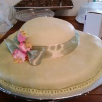 Hat Cake!  A sun hat cake to go along with our garden tea party theme for my best friend's bridal shower.White cake with lemon curd filling, MMF...