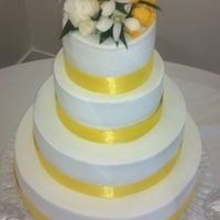 "Sachs Wedding July 9, 2011  Made for a co-worker's son's wedding.Stacked four tier white buttercream with ""lemonade"" colored ribbon. Fresh flower..."