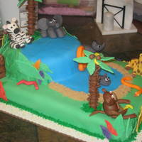 Animal Jungle Cake Johnny's second birthday cake, First animal figures I have ever made .50/50 gum paste/fondant mix.BC covered with fondant on both...