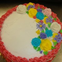 Yellow Buttercream Cake With Royal Icing Flowers