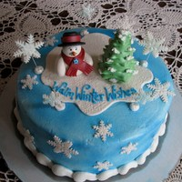 Warm Winter Wishes This cake is covered with buttercream and sprayed with blue food coloring. I hand sculpted the snowman and tree and the snowflakes were cut...