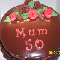 Chocolate Heaven I made this for a friend's Mum who turns 50 this Sunday.Chocolate cake with chocolate ganache buttercream, covered in ganache,...