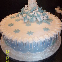 Cold Christmas I made this for my sister. A traditional rich fruit cake covered in marzipan and royal icing with royal icing runouts and decoration and...