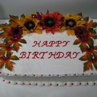 Fall Birthday Cake   This cake was my first attempt at using silk flowers! Wow! A lot less stressful!!! Iced in BC.