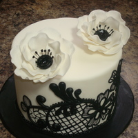 Black Lace  white fondant covered cake.. black royal icing free hand piping.. thin lines were hand painted with black gel color.. i copied the design...