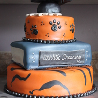 Grad Cake This was for a college graduation all done in fondant for a friend of mine! His school mascot was a tiger...