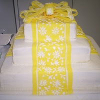 Yellow And White Reception Cake This cake was done for a reception at my church. White cake with lemon fondant and lemon bc filling. I was unhappy with the bow because I...