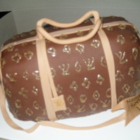Louis Vouitton Cake Strawberry Cake with Cream Cheese Filling. Covered in Chocolate Fondant.