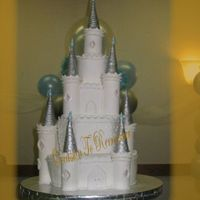 Cinderella's Castle 4 tiers of Almond cake with Pineapple filling. Towers made of pastillage, and then covered with fondant. Turrets are sugar cones covered...