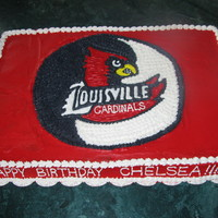 University Of Lousville Cake 12x18 cake - half chocolate half white with buttercream icing- free handed design work from an idea off the internet
