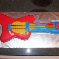 Ben's Guitar Cake Chocolate cake with chocolate ganache filling and buttercream frosting.