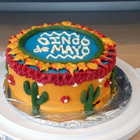 Cinco De Mayo  4 layer yellow cake with all buttercream. Made this for a work potluck- I was in a rush with the writing plus I ran out of the colored BC...