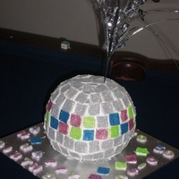 Disco Glitter Ball Cake I'm new to cake decorating, but I was fairly pleased with this, my first ever Disco Ball Cake I was asked to do for a friend's...