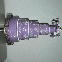 "Purple Sweat Peas On Fondant 2"",4"",6"",8"" and 10"" covered in a purple fondant. My gumpaste Sweat Peas and the royal icing scrolls are by my..."
