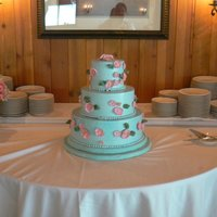 Blue Cake With Pink Anemones This is a blue Italian meringue buttercream iced wedding cake with pink Japanese anemones and was inspired by one of Elisa Strauss's...