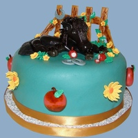 Black Beauty This beautiful mare is handcrafted with gum paste. Fence is also of gum paste; flowers and apples are fondant.