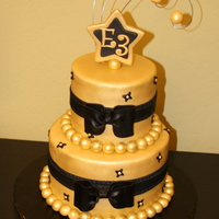Golden Cake  made this for a friend's Christmas party at work. They requested the cake to be Gold with black accents to go with their motif and &...