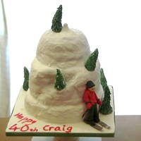 Ski Mountain Chocolate cake covered with fondant and some royal ice. Trees and figure made with fondant mixed with CMC.