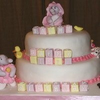 Baby Elephants And Nursery Toys 2 tier sponge. Models made from sugarpaste with cmc.