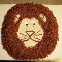 Lion Cake For A Safari Themed Baby Shower Simple cake with buttercream icing and coconut for the mane.