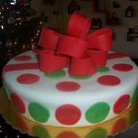 "Christmas Package A ""gift"" cake I did.. everything fondant. Actually from this angle it looks like the cake is lopsided... kind of coming to a..."