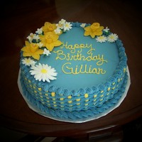 Daffodil Birthday Cake   12 inch round, buttercream icing, basketweave, flowers made out of fondant/gumpaste.
