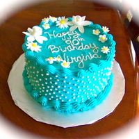 Teal Birthday Cake   8 inch cake, buttercream icing, shell border, flowers made from gumpaste/fondant