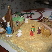 "Nativity Scence Cake fondant and gumpaste figures, gingerbread manger and fence, grated shortbread cookie ""sand"""