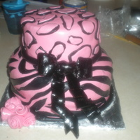 Pussy Cat Dolls Cake I thought that animal print fit the theme the best, plus my aunt loves pink. all in fondant and a sugar bow. fondant roses i felt that gum...