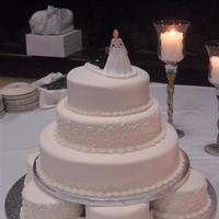 My First Wedding Cake This was for a couple who wanted an all white weddingcake. And they wanted it really plain: no flowers or anything. That's why I...