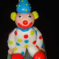 Clown Made of gumpaste w/fondant hair and dots.