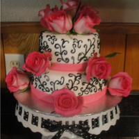 "Elegant Wedding Shower Chocolate cake covered in white fondant with black buttercream piping. The ""ribbon"" around the bottom is bright pink fondant. The..."