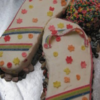 Flip Flops Rice Krispy cake and hacky sac. Used nerds, start burst and sour strips with BC and RI as glue. Young lady who received was pleased. She...