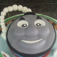 Thomas The Train  There are so many great Thomas the Train cakes on this site....I took ideas from several and combined them. This is what I got. The cake...