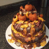 Fall Harvest   Pumpkin are inverted cupcakes shaved to shape. Squash, apples, mini pumpkins and leaves are fondant.
